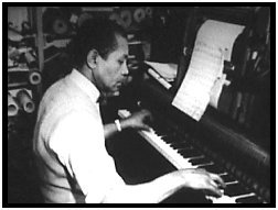 J. Lawrence Cook manually playing piano